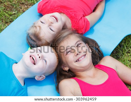 Close-up of cheerful children outside - stock photo