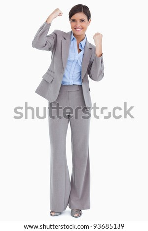 Close up of cheering female entrepreneur against a white background - stock photo