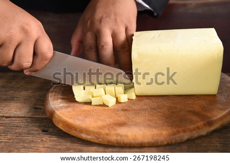 close up of cheese for making pizza. - stock photo