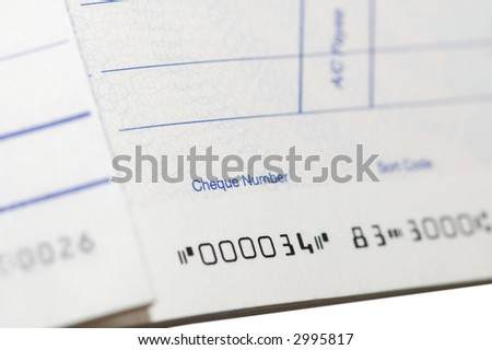 Close up of cheque book - shallow  depth of field - stock photo