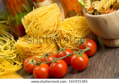 close-up of cherry tomatoes and pasta, still life