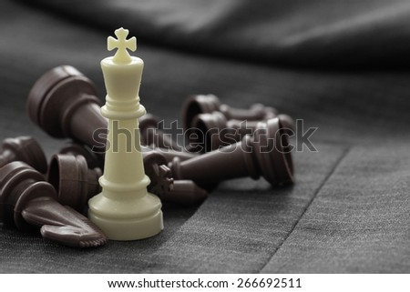 close up of chess figure on suit background strategy or leadership concept - stock photo