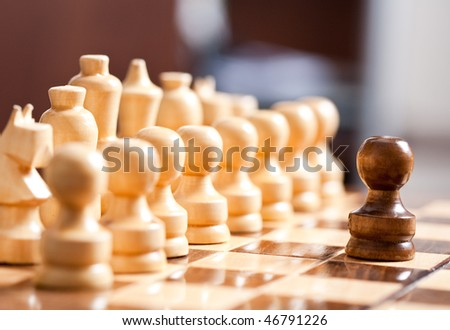 Close up of chess pieces on the board, shallow depth of field - stock photo