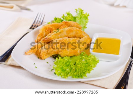 Close Up of Chicken Strips with Mustard Dipping Sauce on White Plate - stock photo