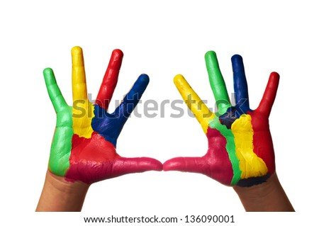 Close up of child hands painted with watercolors, on white background