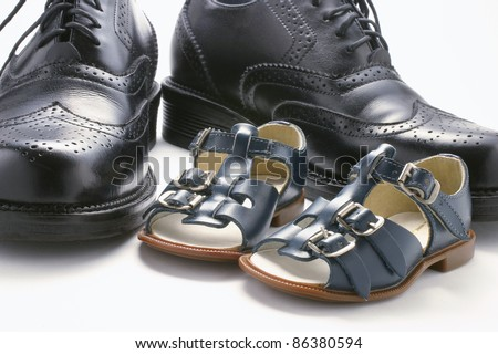 Close Up of Children and Men's Shoes