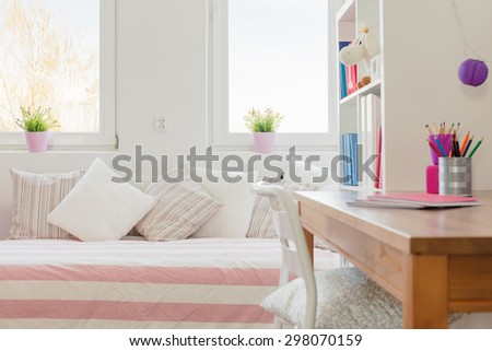 Close-up of children study space with wooden desk - stock photo