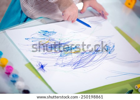 Close-up of childs hands drawing - stock photo