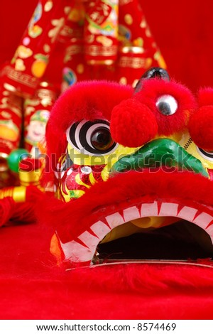 Close up of chinese lion head decoration over red background - stock photo