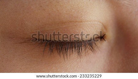 Close up of Chinese woman's closed eye - stock photo