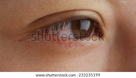 Close up of Chinese woman's eye - stock photo