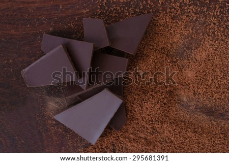 close up of  chocolate and cacao powder on wooden table - studio shot  from above - stock photo