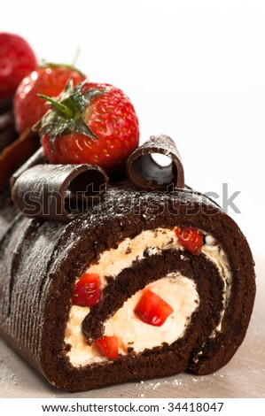 Close up of chocolate cake decorated with strawberries