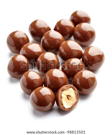 close up of  chocolate candy with nuts on white background - stock photo