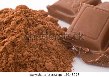 Close- up of chocolate powder and chocolate blocks - stock photo