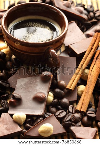 close up of chocolate with hazelnuts, shallow dof - stock photo