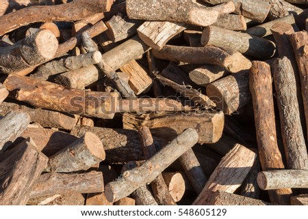 Close up of chopped firewood on a messy stack