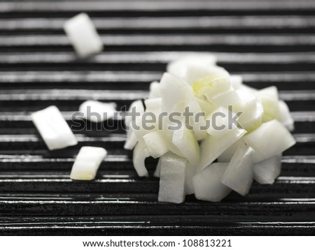 close up of chopped onions on a grill