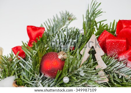 Close-up of Christmas ball on fir Christmas wreath (shallow DOF) - stock photo