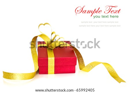 Close up of christmas gift box with gold ribbon bow on white background with copy space. - stock photo