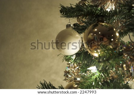 Close up of christmas tree  decorations Main focus on white bulb) - stock photo
