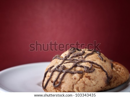 close up of Chunky Chocolate Chip Cookie over red background