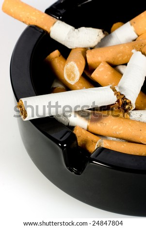 Close-up of cigarettes butts in ashtray - stock photo