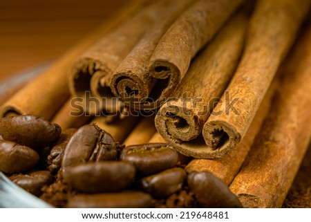 Close up of  cinnamon and coffee heap. Selective focus. - stock photo