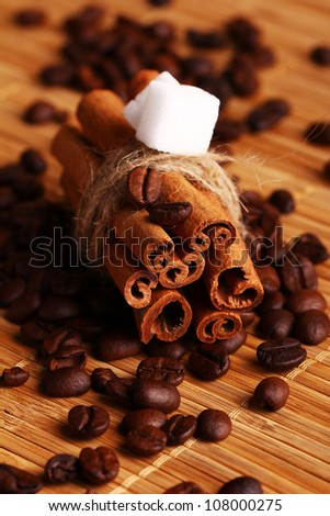 Close up of cinnamon sticks and coffee beans