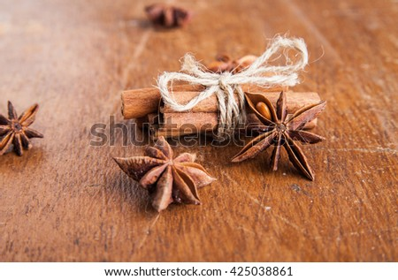 Close up of cinnamon sticks and star anise on rustic wood - stock photo