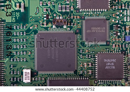 Close up of circuit board of hard drive - stock photo