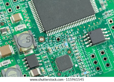 Close up of circuit board with electronic components - stock photo