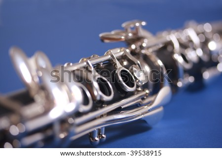 Close up of clarinet on blue background - stock photo