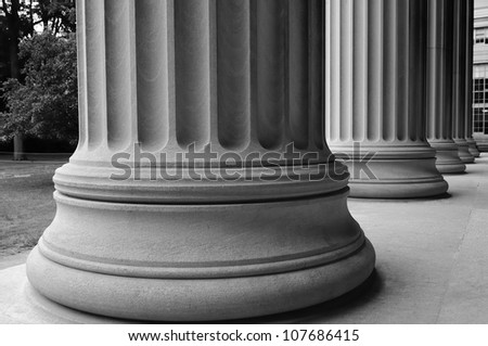 close-up of classic columns in black and white - stock photo
