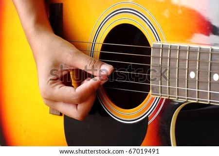 Close-up of classic guitar - stock photo