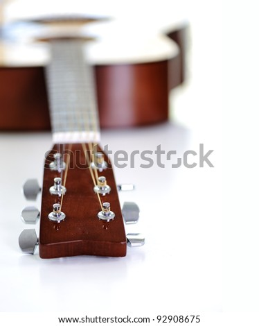 Close up of classic guitar with shallow depth of field - stock photo
