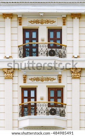 Close up of classic style building focus on balcony, column, baluster and window detail.