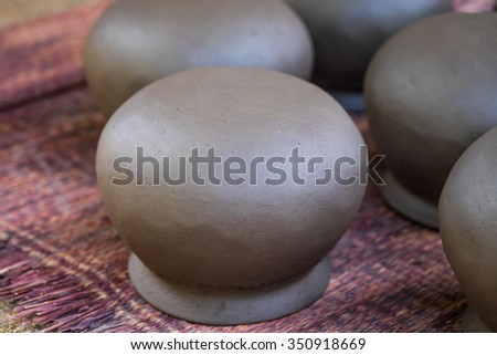 Close up of clay pot the be heated by fire for traditional kitchenware with selective focused point - stock photo