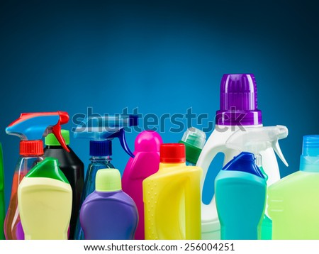 close-up of cleaning supplies and products against blue background - stock photo