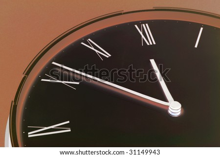 Close Up of Clock Face in Warm Tone - stock photo