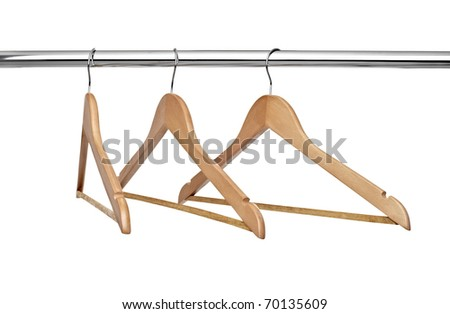 close up of  cloth hangers in row on white background - stock photo