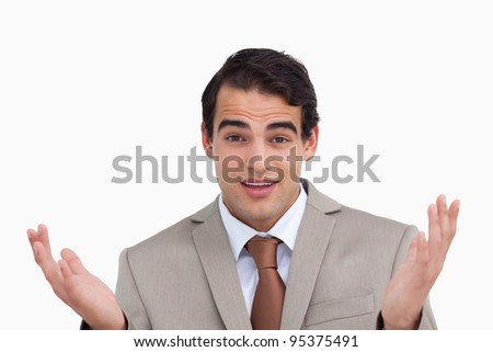 Close up of clueless salesman against a white background - stock photo