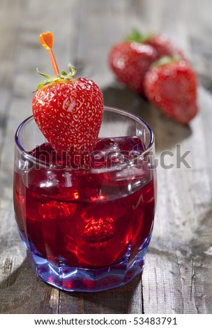Close up of cocktail of strawberry liqueur - stock photo