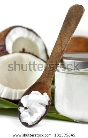 Close-up of coconut oil on the wooden spoon. Beauty and cuisine. - stock photo
