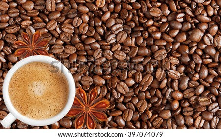 Close-up of coffee beans background and white coffee cup - stock photo
