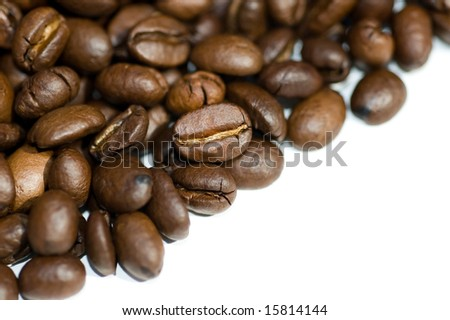 Close up of coffee beans isolated on white background