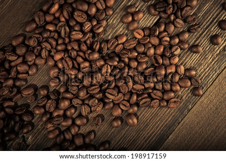close up of coffee beans on a wooden table