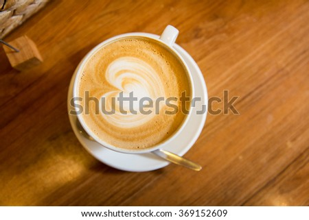 close up of coffee cup with heart shape drawing - stock photo