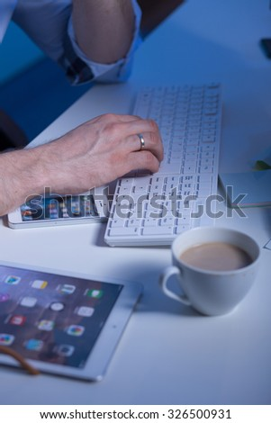 Close-up of coffee with milk on the working man's desk - stock photo