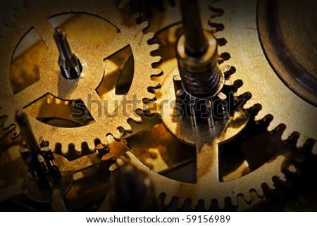 close up of cogwheels in clockwork - stock photo